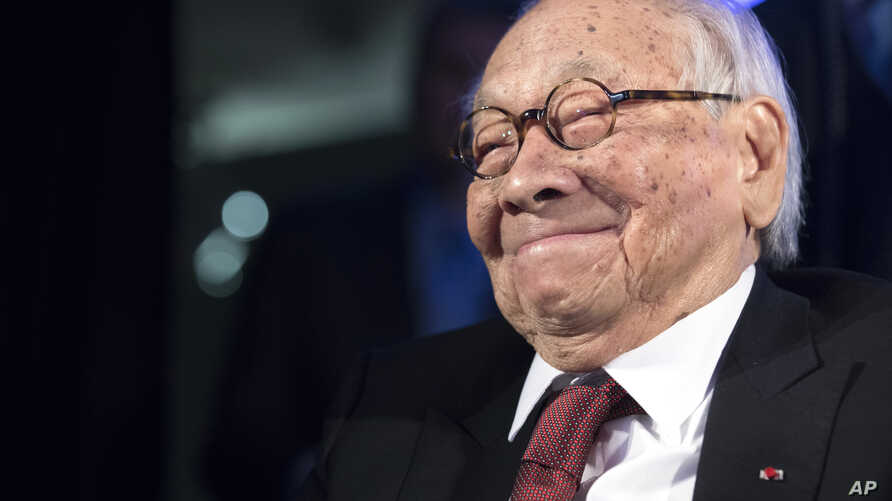 FILE - Chinese American architect I.M. Pei smiles as he accepts the Lifetime Achievement Award during the 2016 Asia Game Changer Awards ceremony in New York, Oct. 27, 2016.