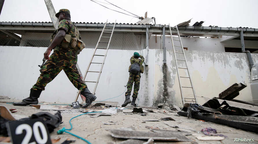 Security personnel are seen at the site of an overnight gunbattle between troops and suspected Islamist militants, on the east coast ofSriLanka, in Kalmunai, April 27, 2019.