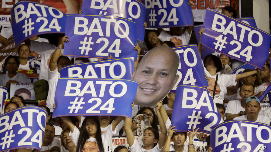 """Supporters raise their posters to cheer their senatorial candidate, former national police chief Rogelio """"Bato"""" Dela Rosa during the last campaign rally by the administration for the midterm elections in suburban Pasig city east of Manila, Philippine..."""