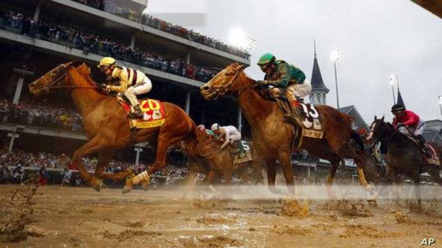 Flavien Prat rides Country House, left, to victory in the 145th running of the Kentucky Derby horse race at Churchill Downs, May 4, 2019, in Louisville, Ky. Code of Honor, right, finished second. Luis Saez on Maximum Security finished first but was d...
