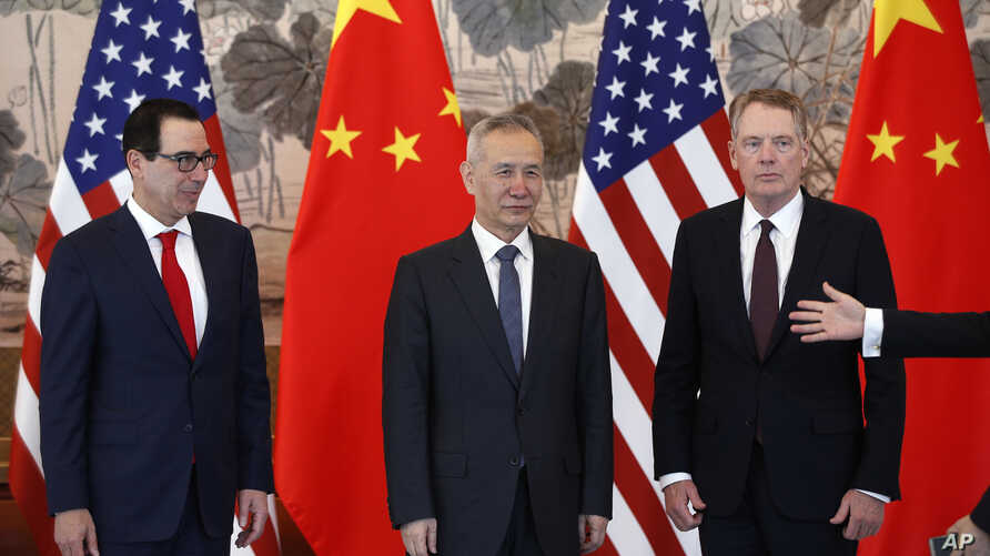 Chinese Vice Premier Liu He, center, U.S. Treasury Secretary Steven Mnuchin, left, and U.S. Trade Representative Robert Lighthizer, right, arrive for a group photo session after concluding their meeting in Beijing, May 1, 2019.