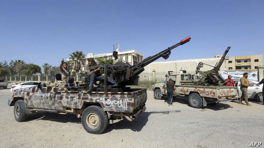 Forces loyal to Libya's Government of National Accord (GNA) celebrate on April 18, 2019, after taking control of al-Aziziyah, located some 40 kilometers south of the capital Tripoli, following fierce clashes with forces loyal to strongman Khalifa Haf...