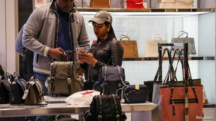 People shop at Macy's Department store in New York City, March 11, 2019.
