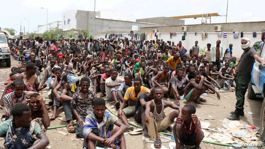Ethiopian migrants, stranded in war-torn Yemen, sit on the ground of a detention site pending repatriation to their home country, in Aden, Yemen, April 24, 2019.