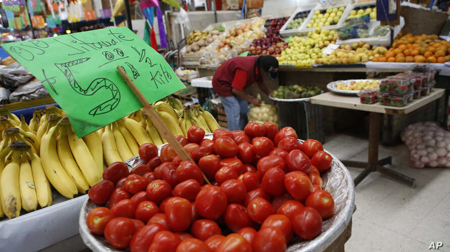 FILE - Mexican tomatoes are displayed for sale at a produce stand in Mercado Medellin, in Mexico City, Feb. 2, 2017.