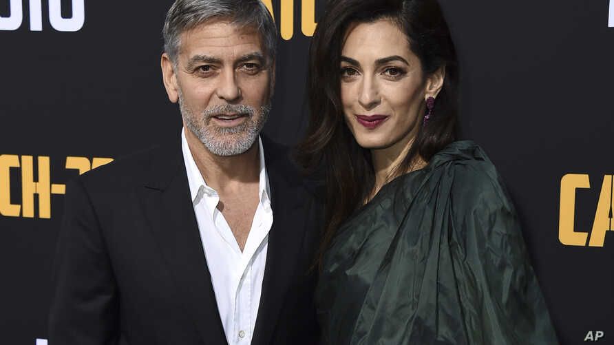 """George Clooney and Amal Clooney arrive at the Los Angeles premiere of """"Catch-22"""" at TCL Chinese Theatre, May 7, 2019."""