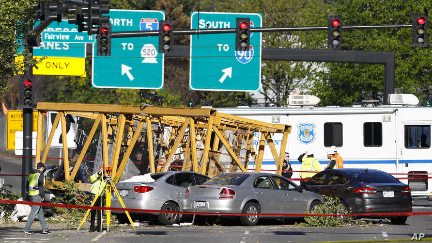 Emergency crews work at the scene of a construction crane collapse where several people were killed and others injured, April 27, 2019, in the South Lake Union neighborhood of Seattle.