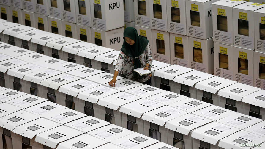An official prepares ballot boxes before their distribution to polling stations in a warehouse in Jakarta, Indonesia, Apr. 15, 2019.