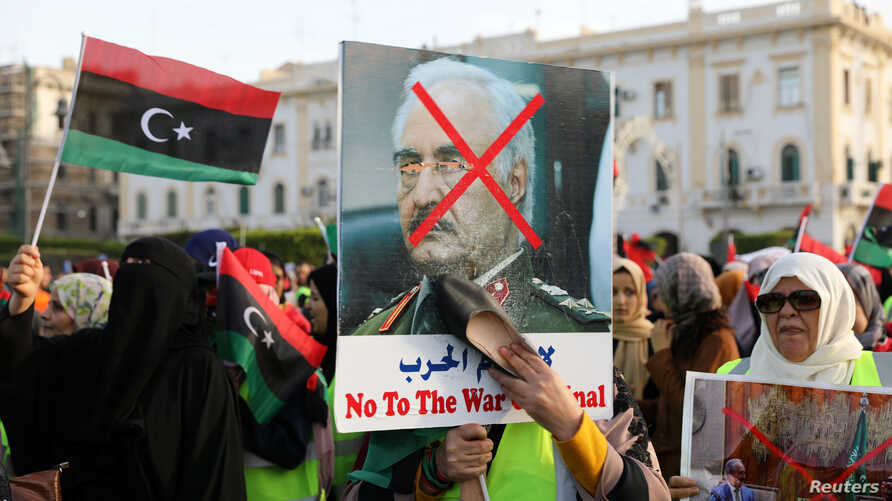 Libyan protesters attend a demonstration to demand an end to the Khalifa Haftar's offensive against Tripoli, in Martyrs' Square in central Tripoli, Libya, April 19, 2019.