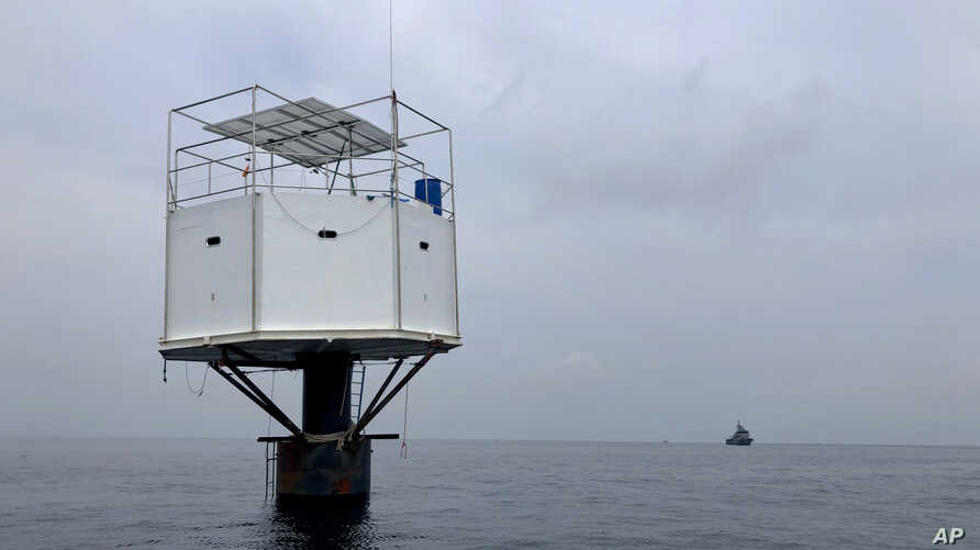 This photo provided by Royal Thai Navy, shows a floating home lived in by an American man and his Thai partner in the Andaman Sea, off Phuket island, Thailand, April 13, 2019.
