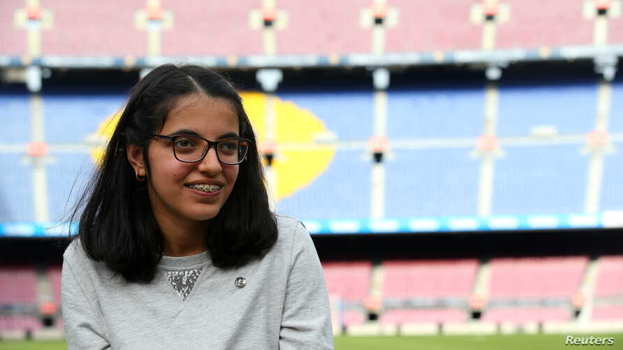 """Syrian refugee Nujeen Mustafa poses after a charity Christmas event """"Nujeen's dream"""" at Camp Nou stadium in Barcelona, Spain, Dec. 14, 2017."""