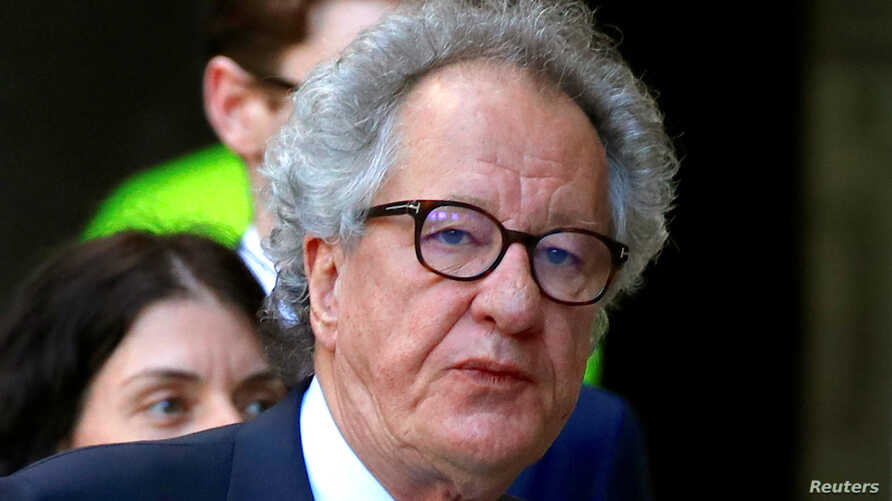 FILE - Australian actor Geoffrey Rush reacts as he arrives at the Federal Court in Sydney, Nov. 8, 2018.