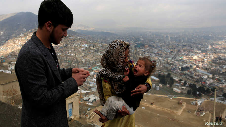 FILE - A child receives polio vaccination drops during an anti-polio campaign in Kabul, Afghanistan.