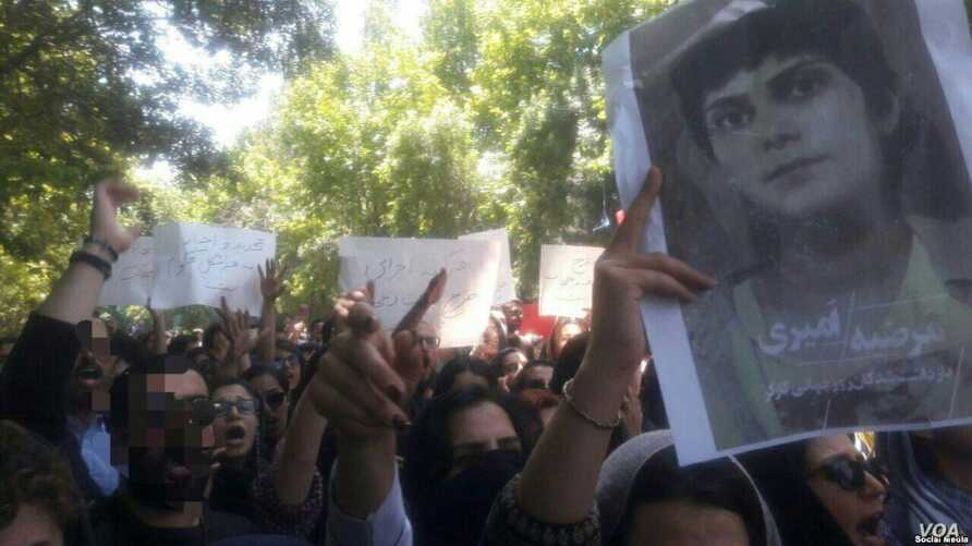 Tehran University students gathered on May 13, 2019, to protest heightened enforcement of mandatory veiling for women during Ramadan and to highlight other concerns such as the May 1, 2019, arrest of journalist Marzieh Amiri, seen pictured on the rig...