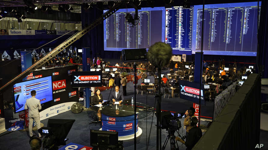 South African television channels report results as they come in from the Independent Electoral Commission Results Center in Pretoria, South Africa, May 9, 2019.