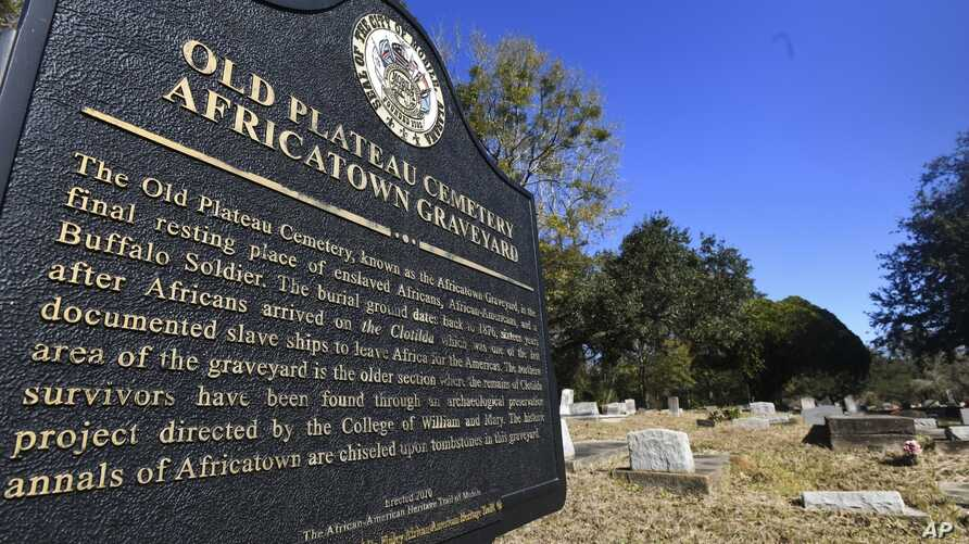 FILE - Old Plateau Cemetery, the final resting place for many who spent their lives in Africatown, stands in need of upkeep near Mobile, Ala., Jan. 29, 2019, Many of the survivors of the slave ship Clotilda's voyage are buried here among the trees.