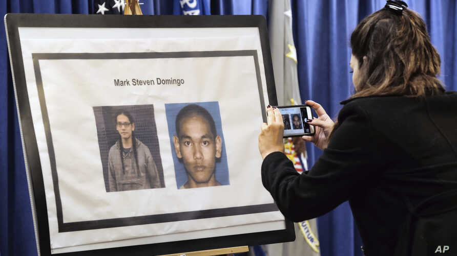 A reporter takes a photo of Mark Domingo, 26, from Reseda, Calif., displayed at a news conference in Los Angeles on April 29, 2019.