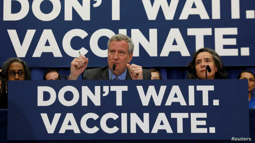 FILE - New York City Mayor Bill de Blasio speaks during a news conference declaring a public health emergency in parts of Brooklyn in response to a measles outbreak, requiring unvaccinated people living in the affected areas to get the vaccine or fac...