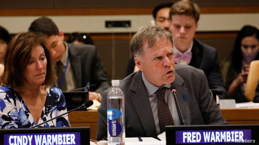 Fred Warmbier speaks as his wife, Cindy, looks on during a symposium on international cooperation to urge the Democratic Republic of Korea to take concrete actions to improve its human rights situation, at the United Nations headquarters in New York,...