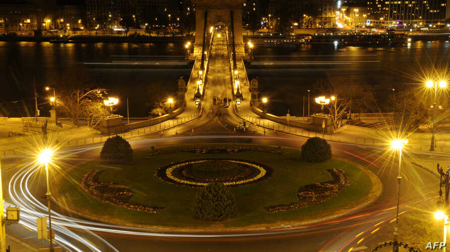 FILE - A picture taken on March 31, 2012 shows the Adam Clark square of Budapest and the oldest Hungarian bridge 'The Chain Bridge' after the city switched off its lights to mark the annual Earth Hour event.