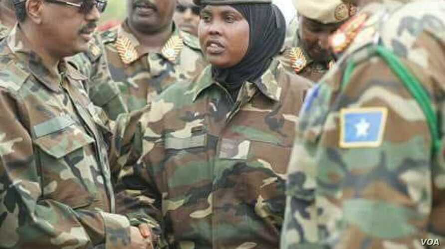 Col. Faadumo Ali is seen shaking a fellow soldier's hand in a undated social media photo (Facebook - Faay Cali Raage).