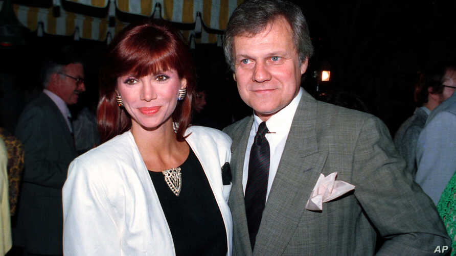 "FILE - This June 13, 1986 file photo shows actress Victoria Principal and actor Ken Kercheval, co-stars of the popular TV-show ""Dallas."" Kercheval, who played Cliff Barnes on the hit TV series ""Dallas"" has died at age 83."