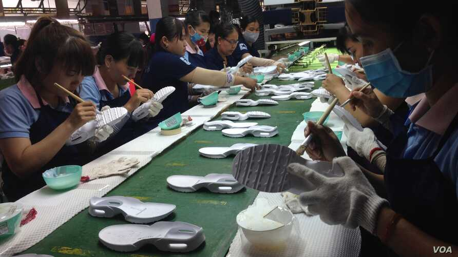 The rise of the textile industry, which includes factory-made shoes like these in Vietnam's Dong Nai province, has brought increasing cooperation between Chinese and Vietnamese businesses.
