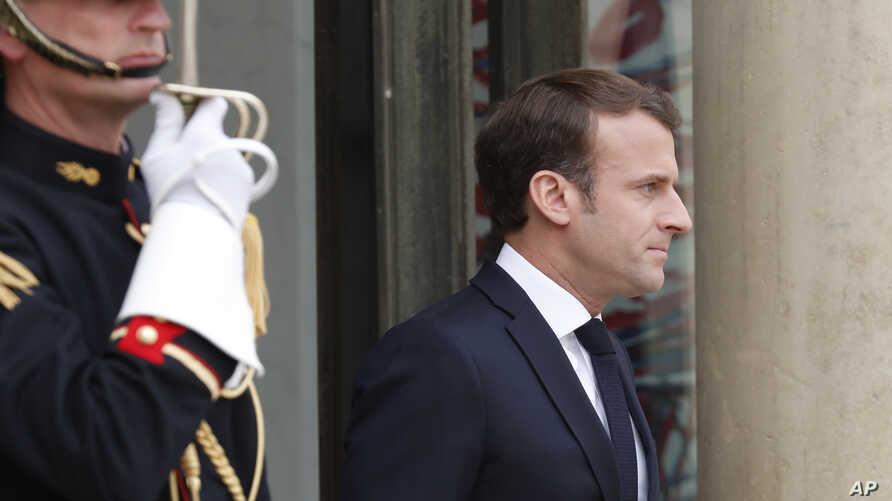 French President Emmanuel Macron waits for Japan's Prime Minister Shinzo Abe at the Elysee Palace in Paris, April 23, 2019.