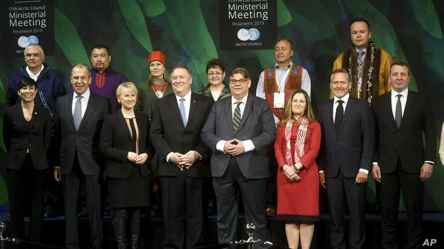 U.S. Secretary of State Mike Pompeo, center-left, and foreign ministers of the eight-member Arctic Council pose for a group photo during a ministerial meeting at Lappi Arena, in Rovaniemi, Finland, May 7, 2019.