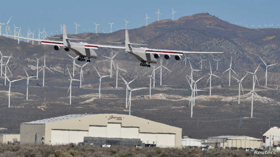 The world's largest airplane, built by the late Paul Allen's company Stratolaunch Systems, lands during its first test flight in Mojave, California, April 13, 2019.