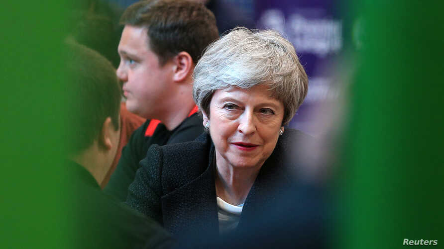 FILE - British Prime Minister Theresa May visits the Leisure Box while on a local elections campaign, in Brierfield, Lancashire, Britain, April 25, 2019.