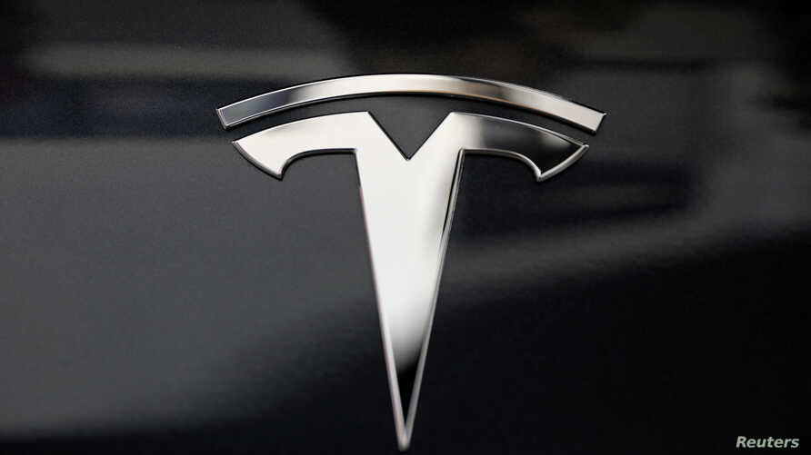 FILE - A Tesla logo is seen in Los Angeles, California US.