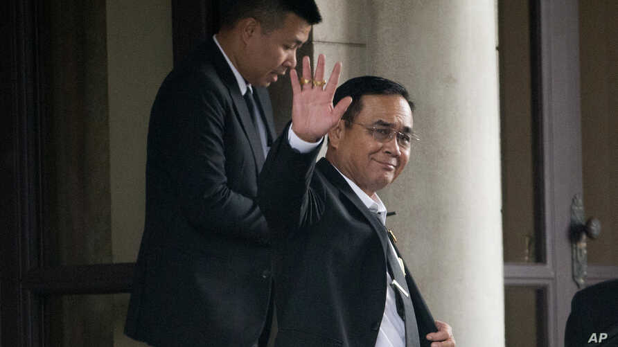 Thailand's Prime Minister Prayuth Chan-ocha waves to the media as he leaves the government house in Bangkok, Thailand, June 5, 2019.