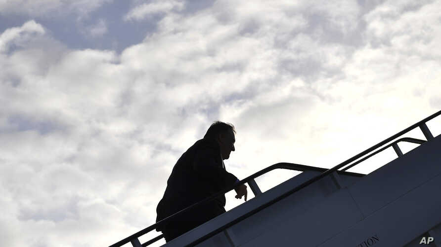 U.S. Secretary of State Mike Pompeo boards a plane before departing from London Stansted Airport, north of London, May 9, 2019.