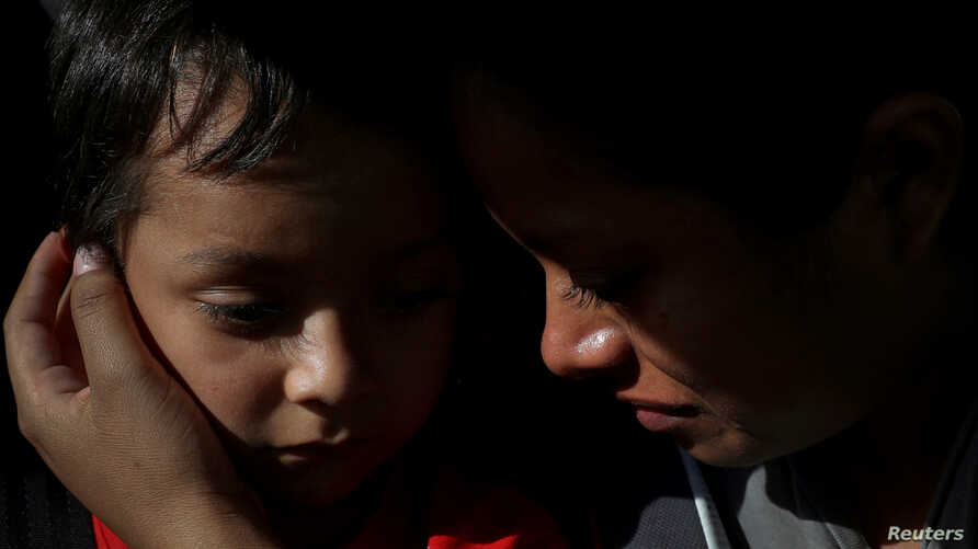 FILE - Anita Areli Ramirez Mejia, an asylum seeker from Honduras separated from her six year-old son Jenri near the Mexico-U.S. border, is reunited with him in Harlingen, Texas, July 13, 2018.