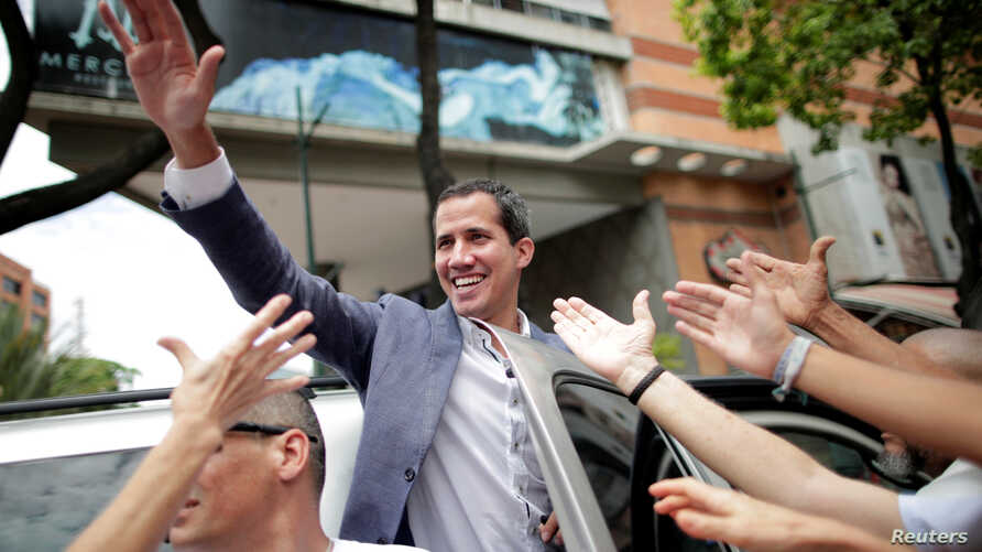 Venezuelan opposition leader Juan Guaido, whom many nations have recognized as the country's rightful interim ruler, leaves after a rally in support of the Venezuelan National Assembly and against the government of Venezuela's President Nicolas Madur...