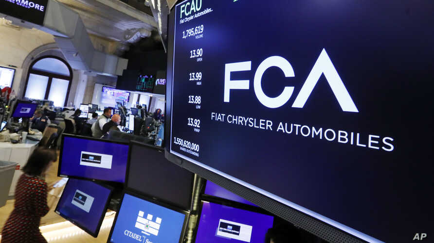 FILE - The Fiat Chrysler Automobiles logo appears above a post on the floor of the New York Stock Exchange, May 28, 2019.