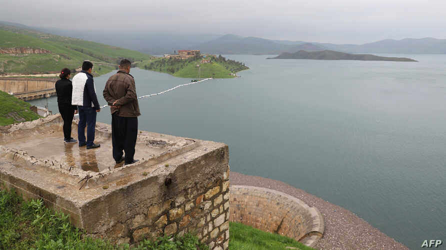 People look at the Dukan dam in Iraq's northern autonomous region of Kurdistan, 65 kms northwest of Suleimaniyah, which was built in 1955 and has reached its highest water levels following heavy rains in the region, April 2, 2019.