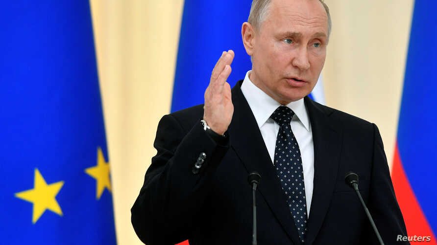 Russian President Vladimir Putin speaks during a joint news conference with his Austrian counterpart following their talks in Sochi, Russia, May 15, 2019.