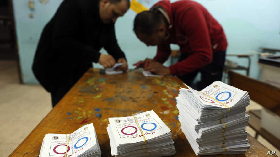 Election workers count ballots at the end of a three-day vote of the referendum on constitutional amendments at a polling station in Cairo, Egypt, April 22, 2019.