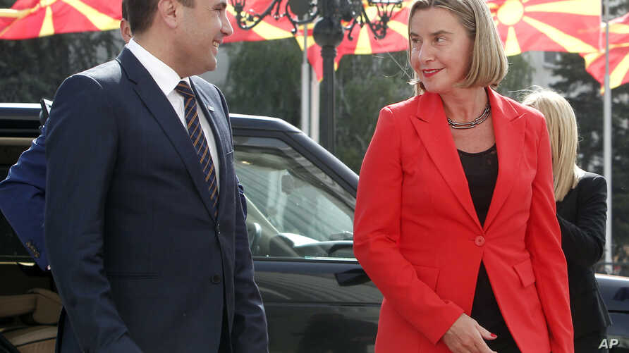 FILE - European Union High Representative for Foreign Affairs and Security Policy Federica Mogherini is welcomed by Macedonian Prime Minister Zoran Zaev (L) upon her arrival in Skopje, Macedonia on April 18, 2018. Mogherini's visit comes a day after ...