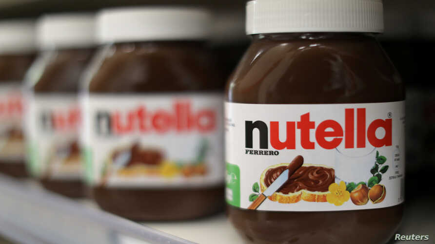 FILE - Jars of Nutella chocolate-hazelnut paste are displayed in a Casino supermarket in Nice, France.