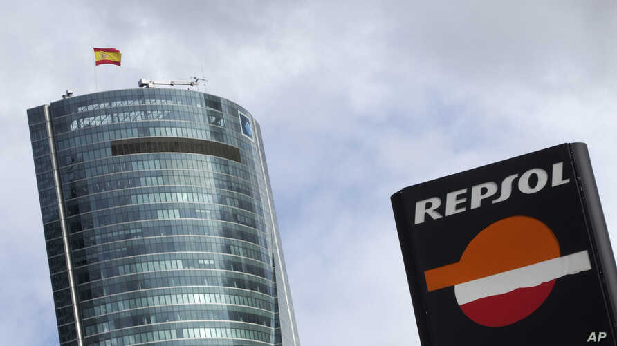 A Repsol logo is seen in front of Torre Espacio building in Madrid April 13, 2012.