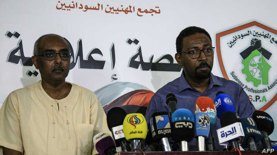 Rashid al-Sayed (L) and Amjad Farid (R), spokesmen for the protest movement, speak to the press in the Sudanese capital Khartoum, April 27, 2019.