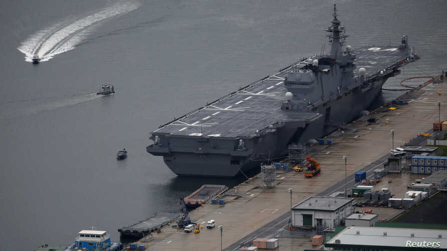 Japan Maritime Self-Defense Force's (JMSDF) latest Izumo-class helicopter carrier DDH-184 Kaga is moored at a naval base in Sasebo, on the southwest island of Kyushu, Japan April 6, 2018.