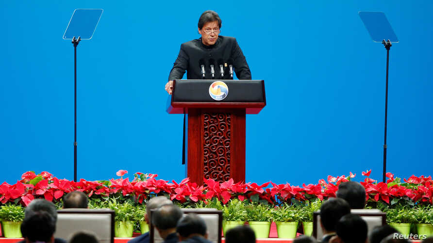 Pakistani Prime Minister Imran Khan delivers a speech at the opening ceremony for the second Belt and Road Forum in Beijing, China, April 26, 2019. REUTERS/Florence Lo - RC134B079720