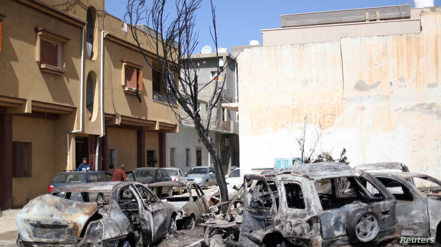 Vehicles damaged by overnight shelling are seen in Abu Salim district, Tripoli, Libya, April 17, 2019.