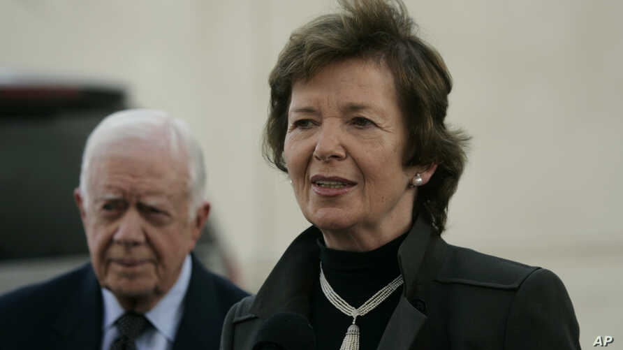 FILE - Former Irish President Mary Robinson, right, and former U.S. President Jimmy Carter speak to press in the West Bank city of Ramallah, Oct. 20, 2010.
