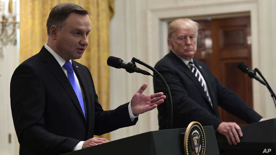 FILE - President Donald Trump, right, listens as Polish President Andrzej Duda speaks during a joint news conference in the East Room of the White House in Washington, Sept. 18, 2018.