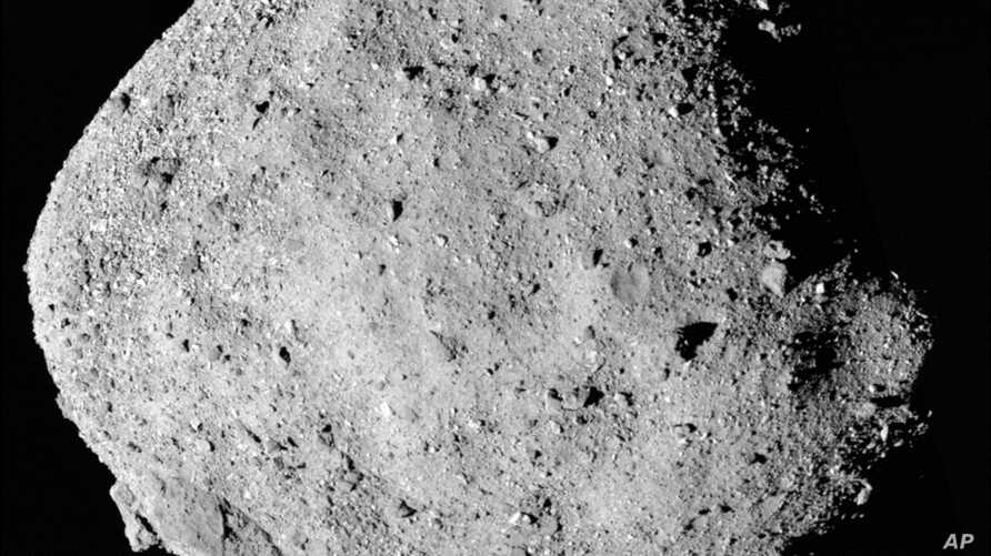 FILE - A file mosaic image composed of 12 PolyCam images collected on Dec. 2, 2018, and provided by NASA shows the asteroid Bennu. (NASA/Goddard/University of Arizona)